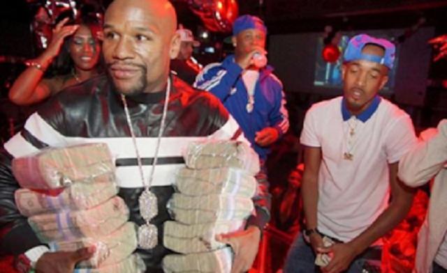 Floyd Mayweather Throws Away £40k At Strip Club